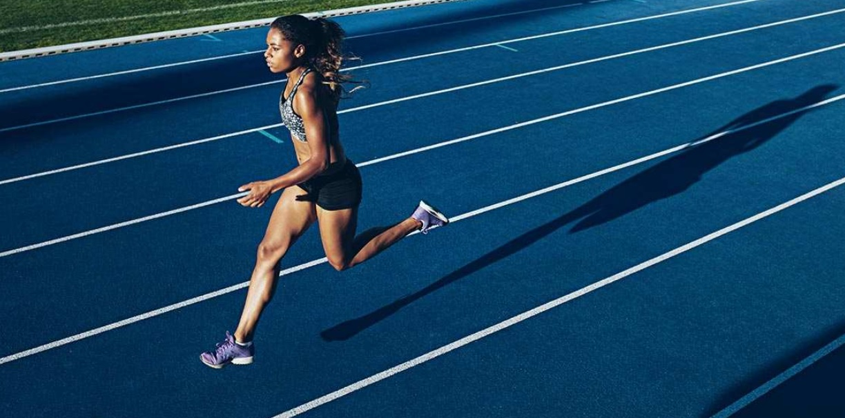 This image depicts an athlete running after using CBD.